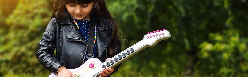 KId Playing Guitar