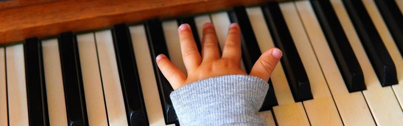 Child Mastering The Piano
